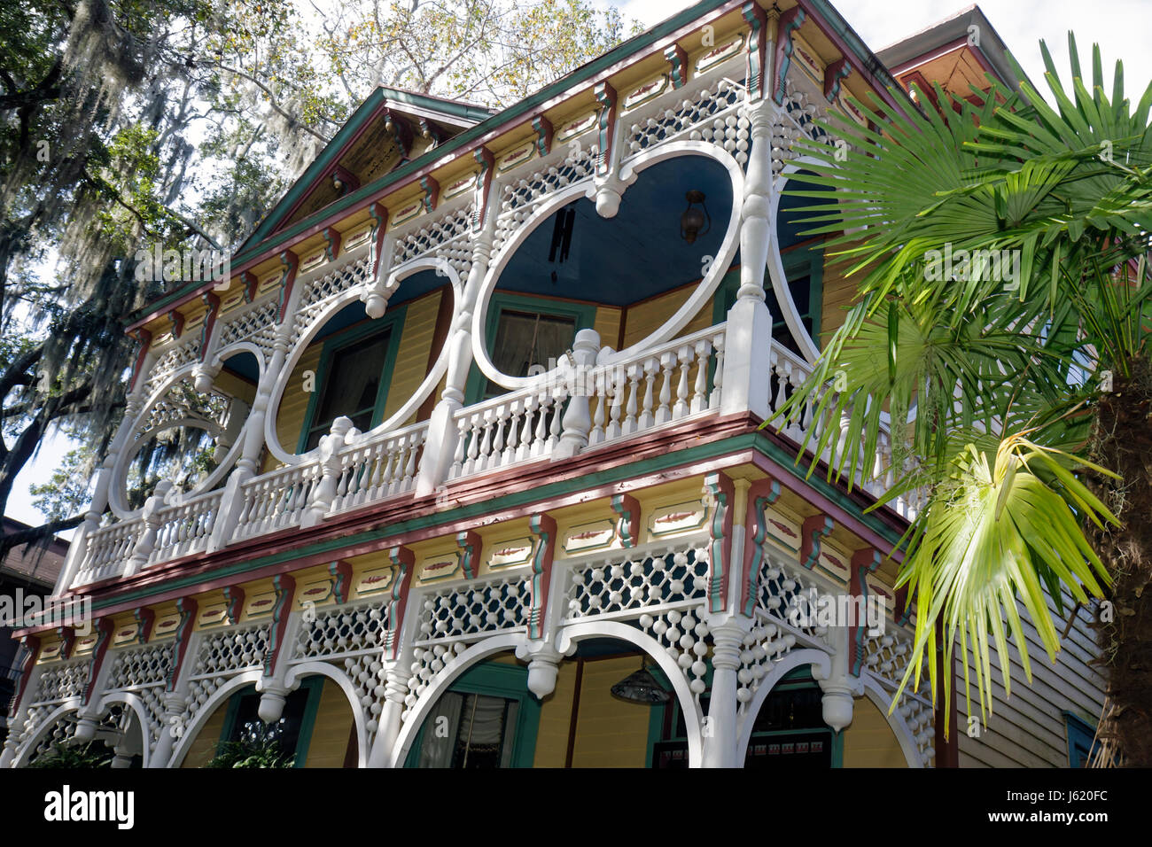 Savannah Georgia Historic District Victorian District Bull Street Gingerbread House Asendorf House1889 home porch - Stock Image