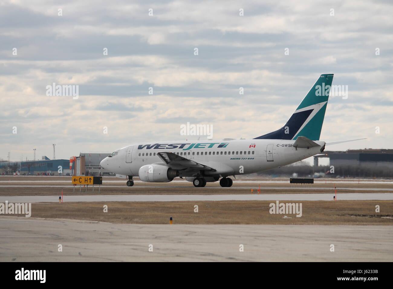 West Jet 736 - Stock Image