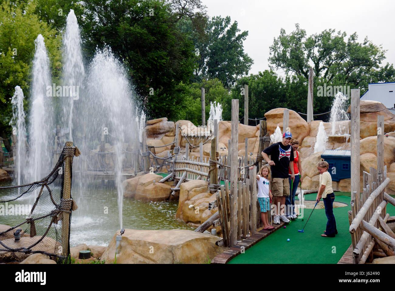 Indiana Valparaiso Zao Island Entertainment Center miniature golf fountains family entertainment man woman boy girl Stock Photo