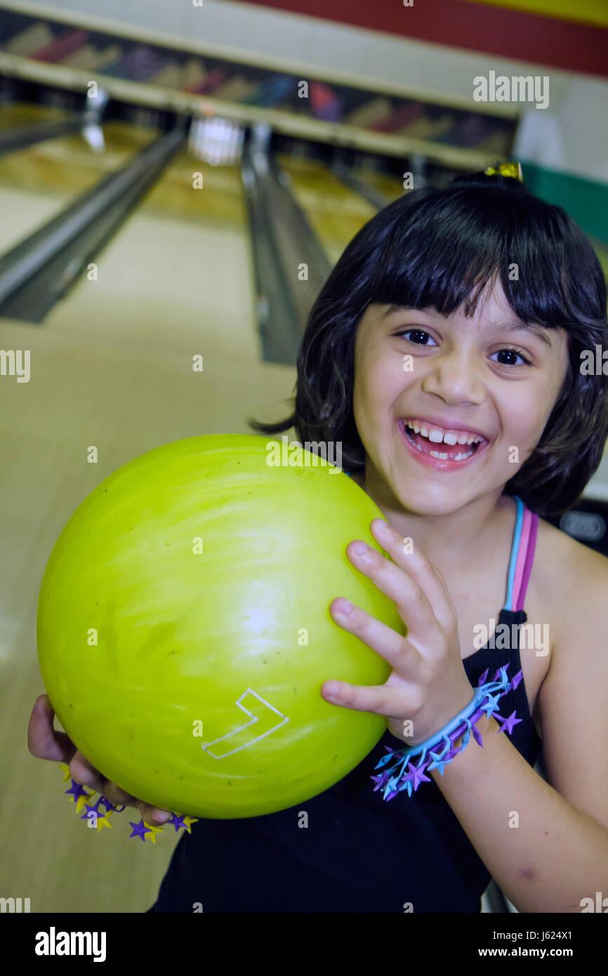 Indiana Valparaiso Inman's Fun and Party Center bowling lane Hispanic girl child ten-pin bowling ball yellow - Stock Image