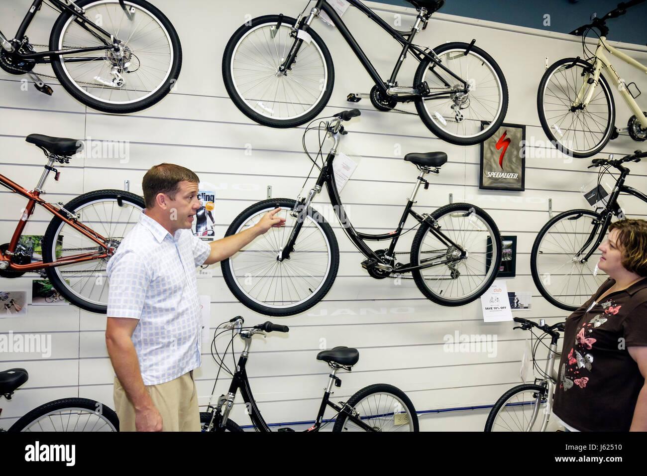 Indiana Valparaiso Jano Bicycles man salesman shop business bike sport exercise equipment sell choices wheel spoke - Stock Image