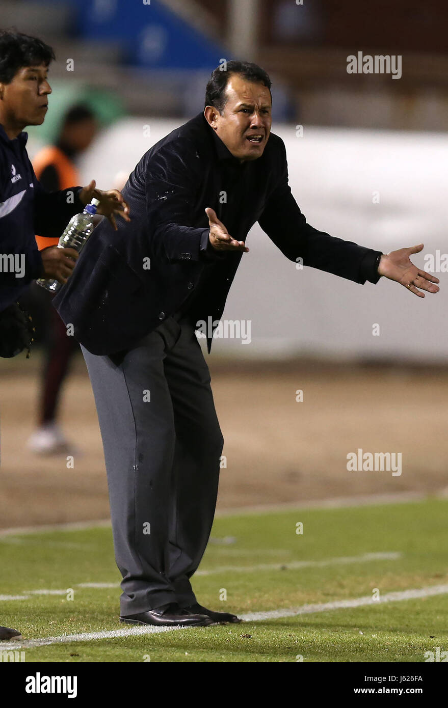Melgar's coach, Juan Reynoso, reacts during a match for the group phase of the Copa Libertadores between Argentina's - Stock Image