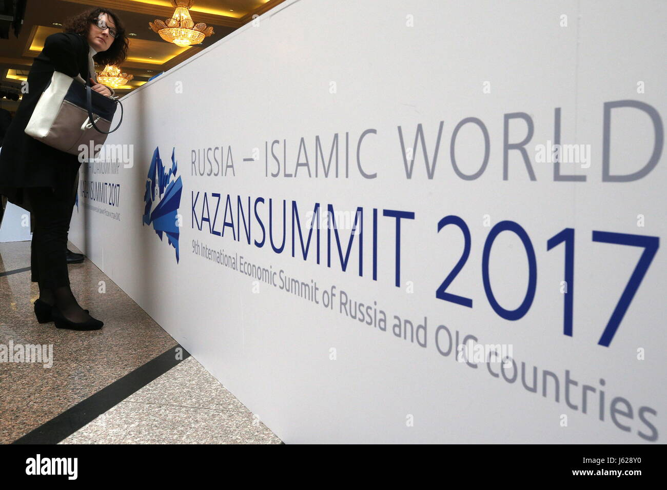 Kazan, Russia. 19th May, 2017. A woman seen at a reception desk at the 9th International Economic Summit titled - Stock Image