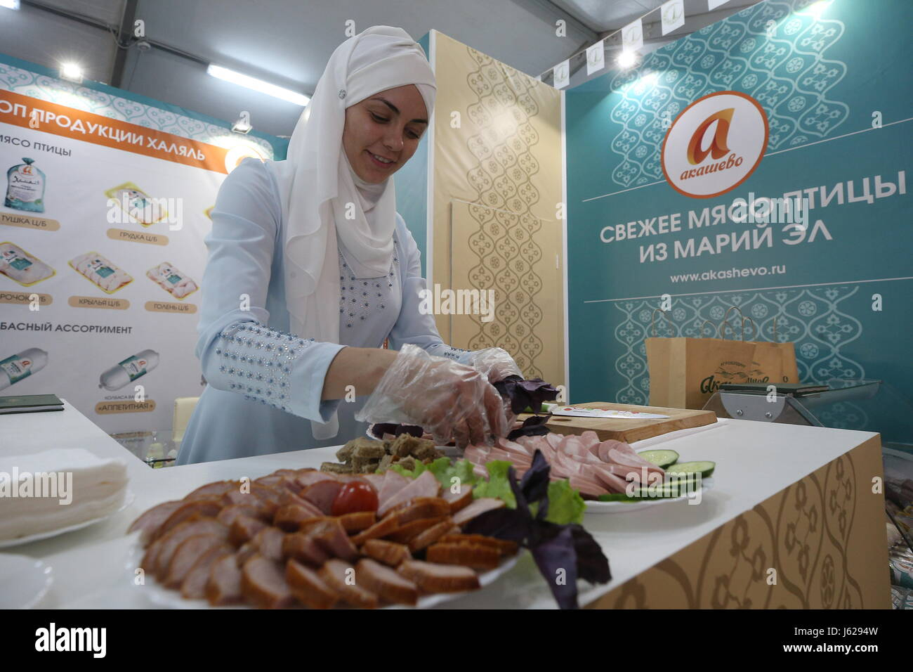 Kazan, Russia. 18th May, 2017. A woman at the Akashevo stand at the Russia Halal Expo exhibition as part of the - Stock Image