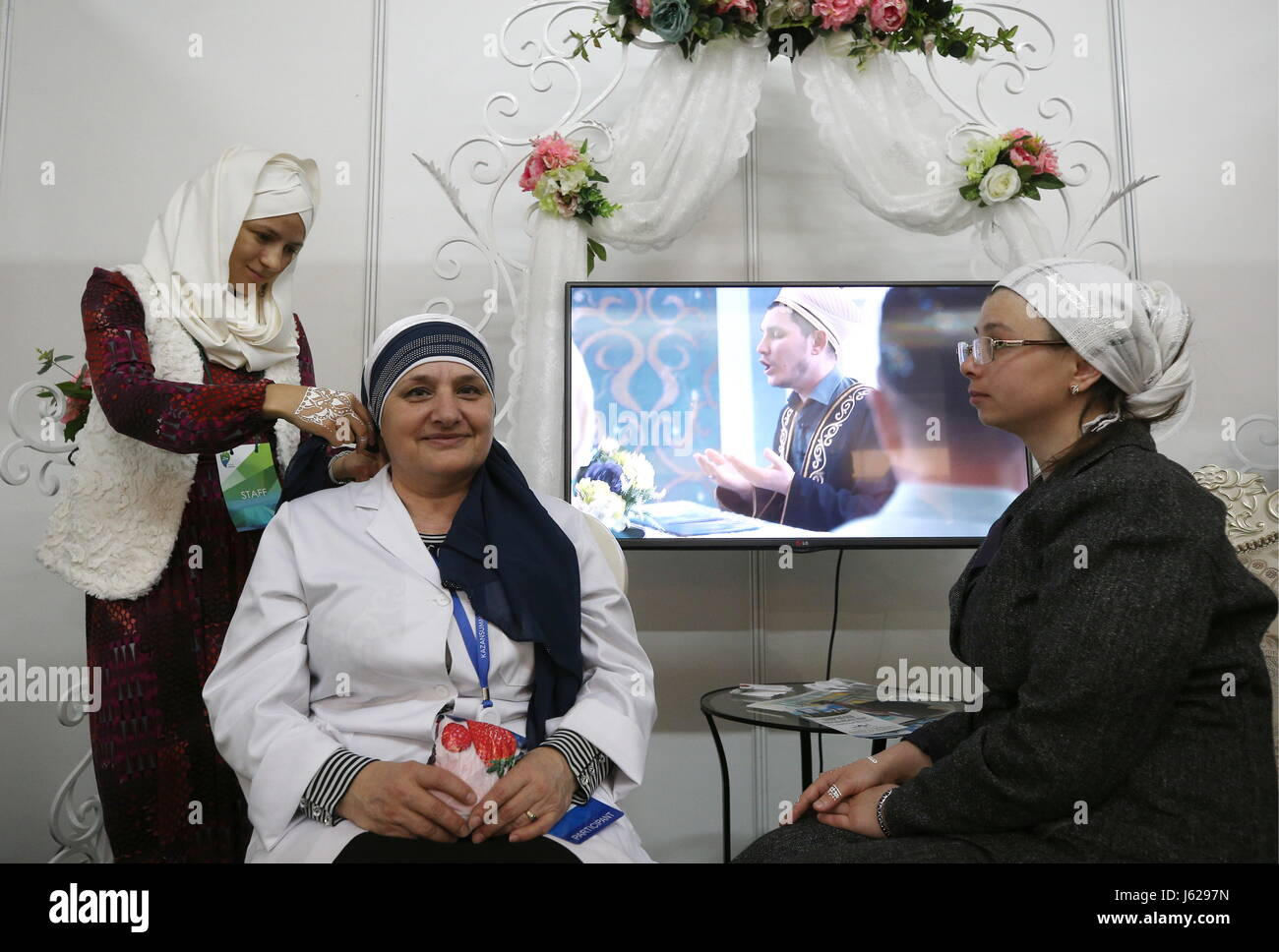Kazan, Russia. 18th May, 2017. People attend the Russia Halal Expo exhibition as part of the 9th International Economic - Stock Image