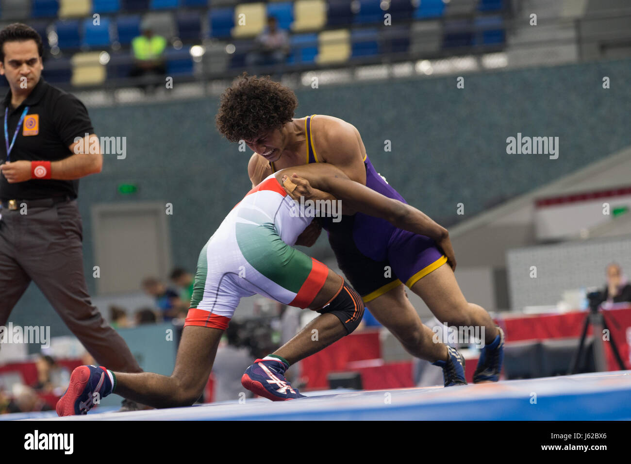Ibrahim A Abdali Khalil Of Saudi Arabia Competes Against Hussain Abdullah Hus Al Azzani Yemen In The Mens Freestyle Wrestling 65kg Repechage During Day