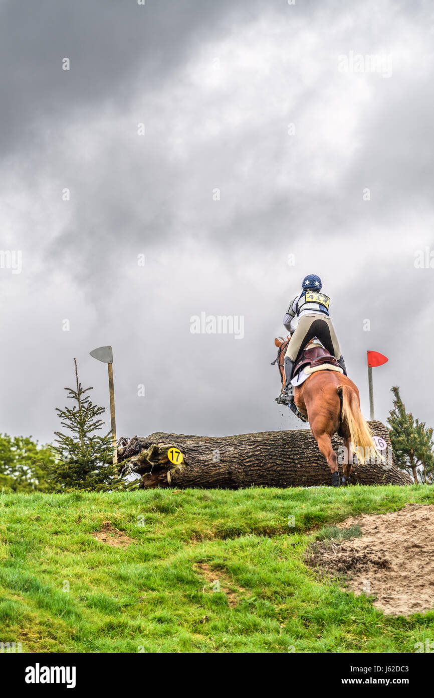 Rockingham Castle grounds, Corby, UK. 19th May, 2017. The horse 'Master Purple'' ridden by Ruth Spencer jumps a Stock Photo