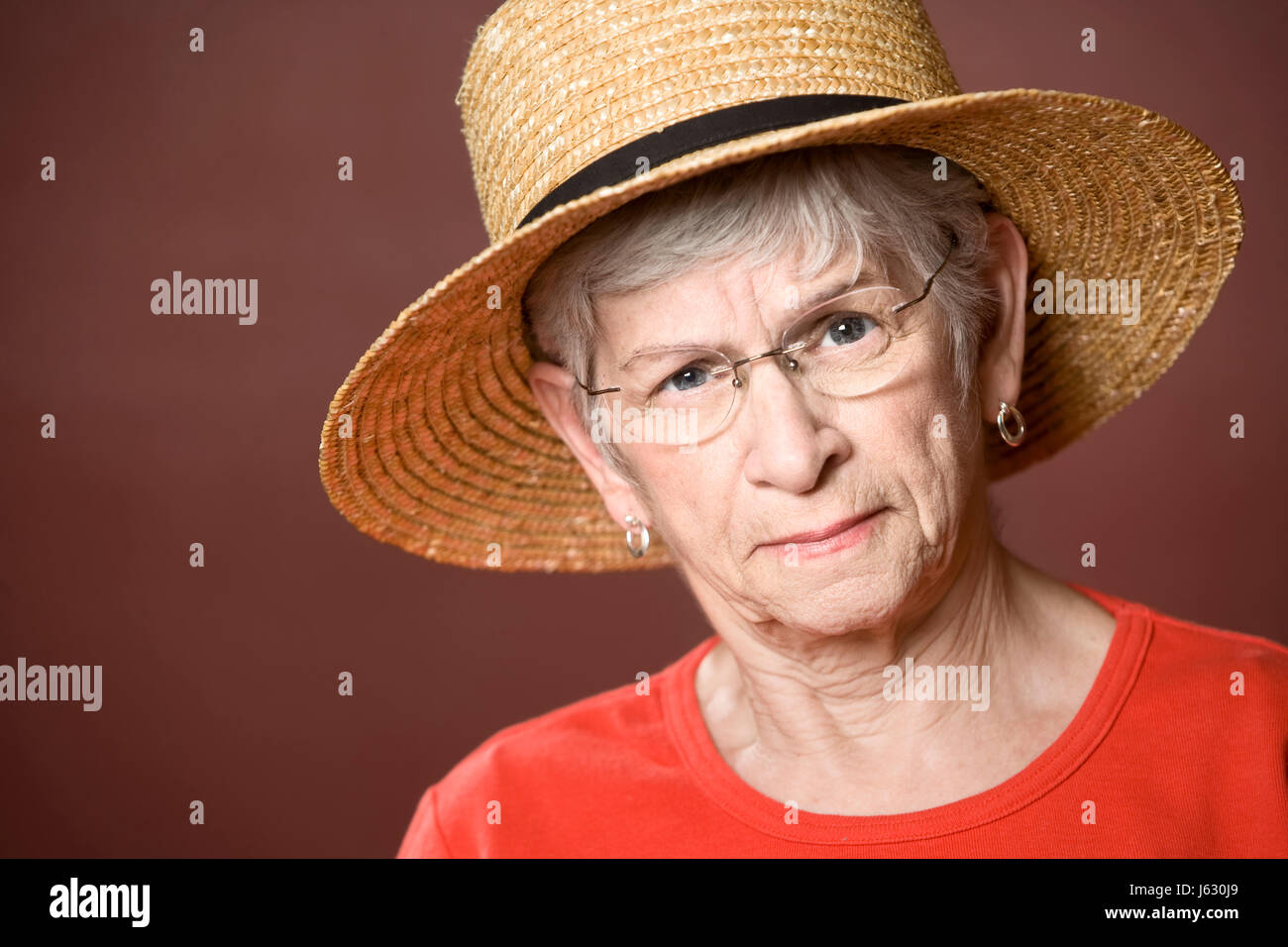 lady female hat eccentric old elderly grey gray elder woman macro close-up Stock Photo