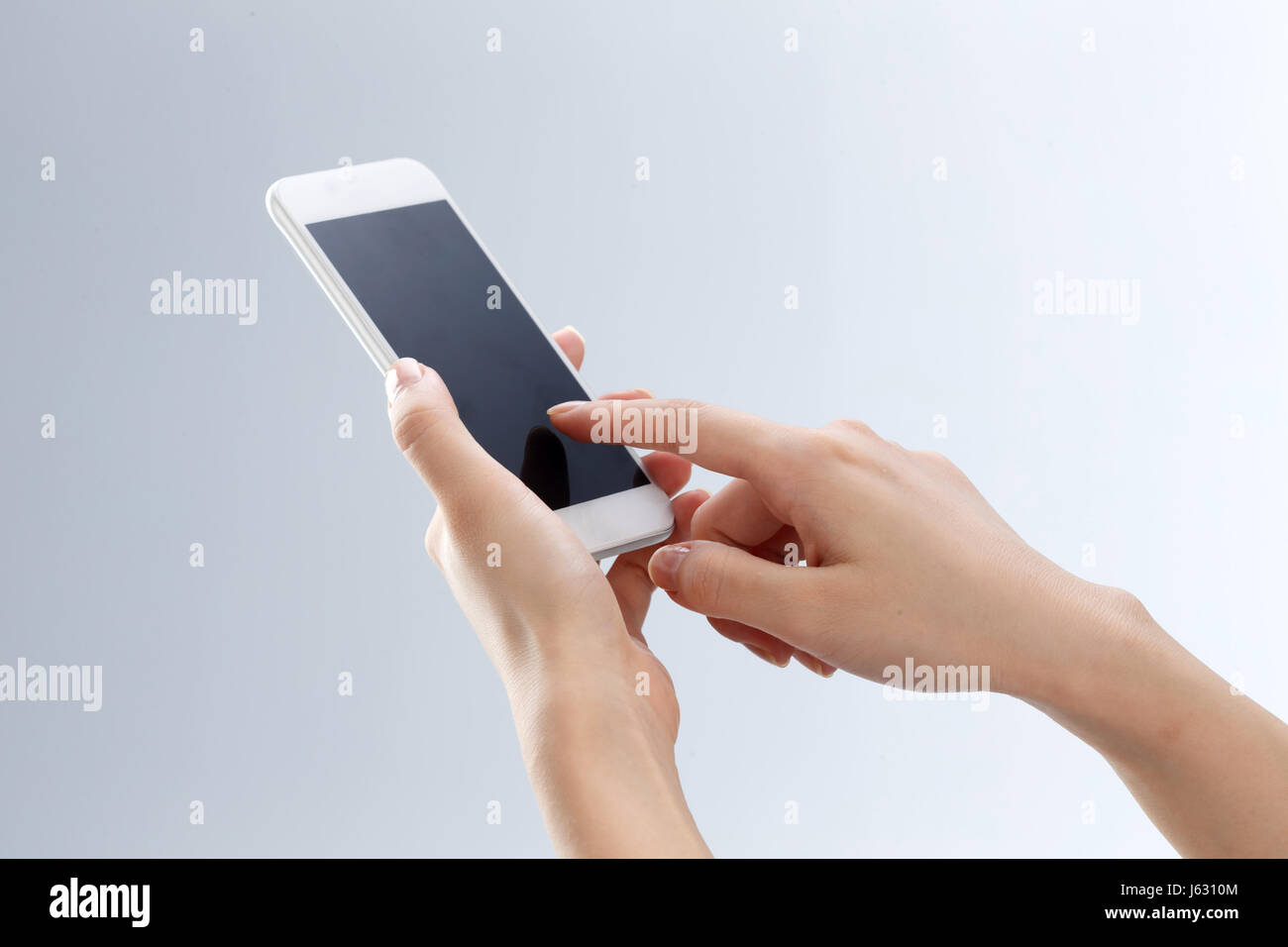 Hand holding mobile phone - Stock Image