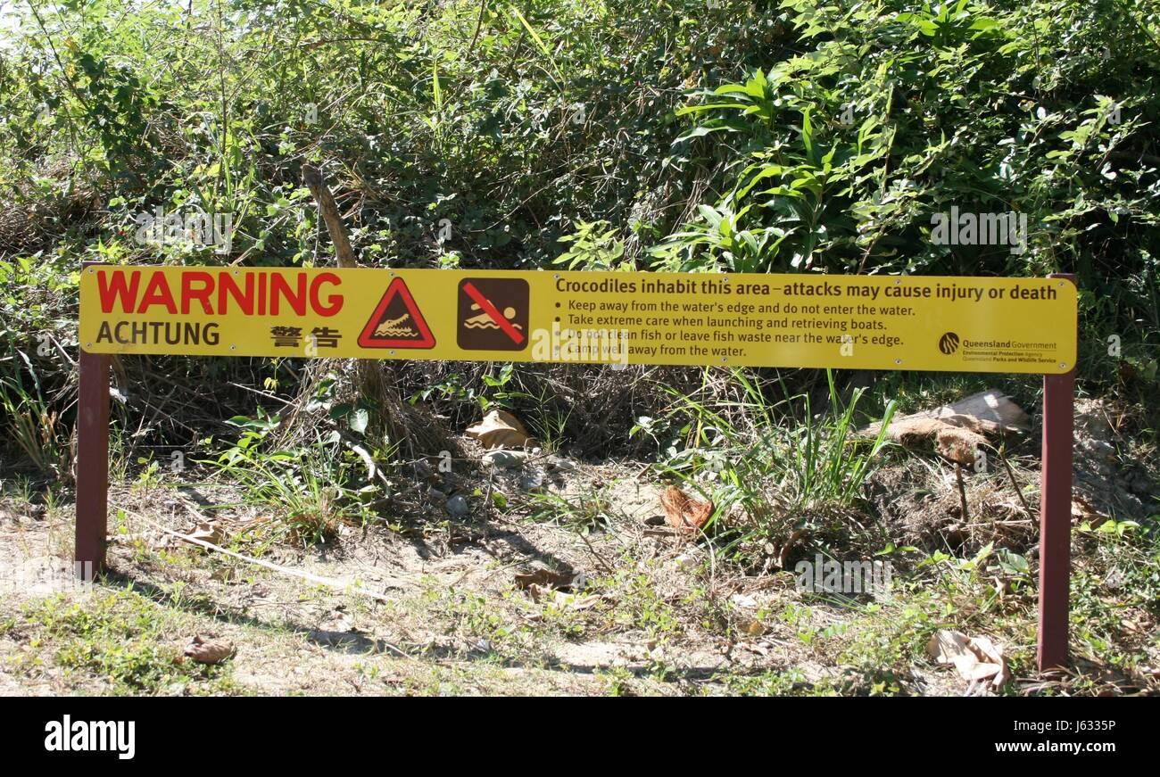 sign signal crocodile australia ban traveling trip journey swimming swiming - Stock Image