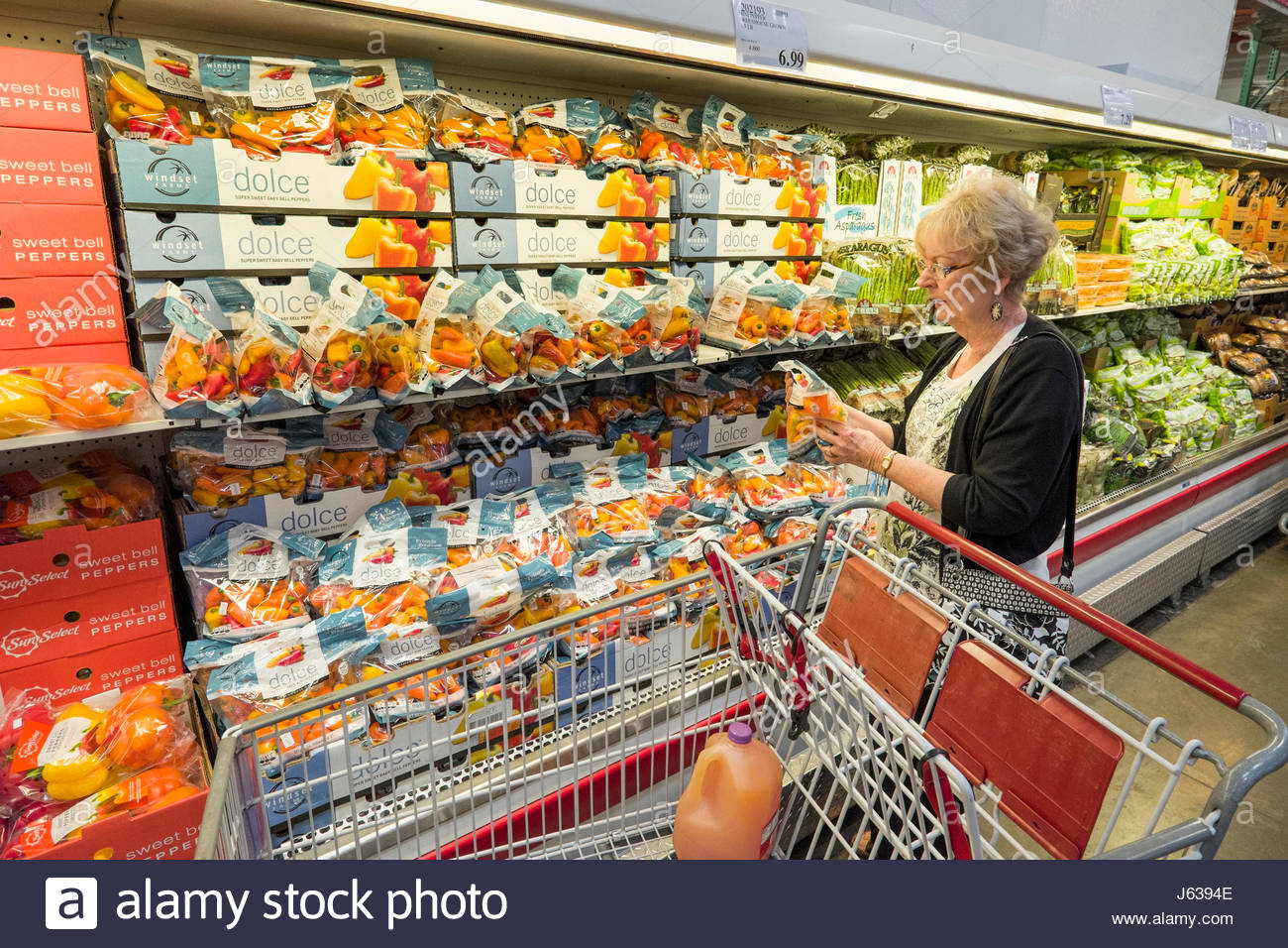 mature woman shopping in costco warehouse supermarket looking at stock photo 141443918 alamy. Black Bedroom Furniture Sets. Home Design Ideas