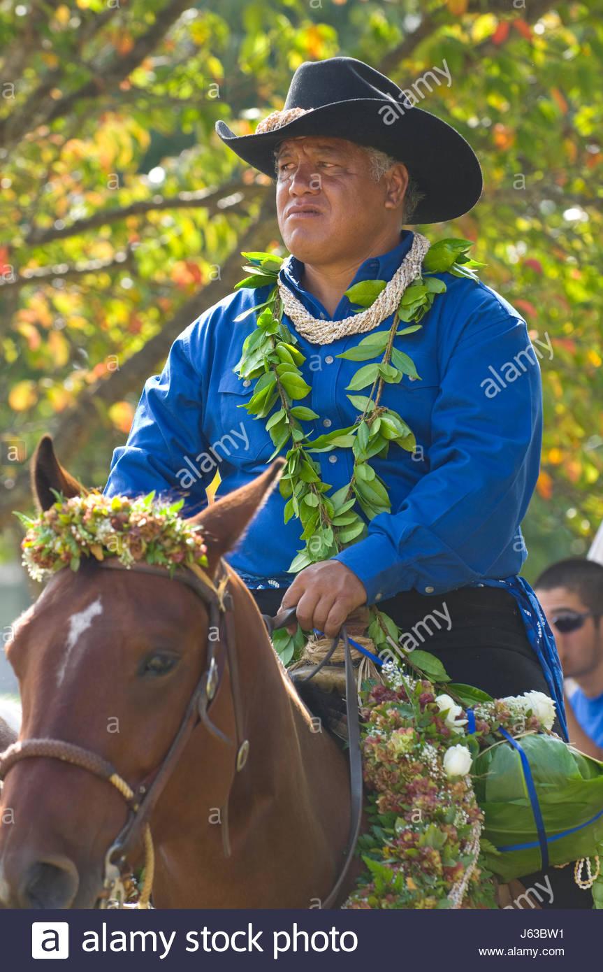 cadfd907 Hawaiian cowboy on horseback wearing a blue shirt and maile lei before the  start of the 33rd Annual Waimea Paniolo Parade, Church Road, Waimea, North