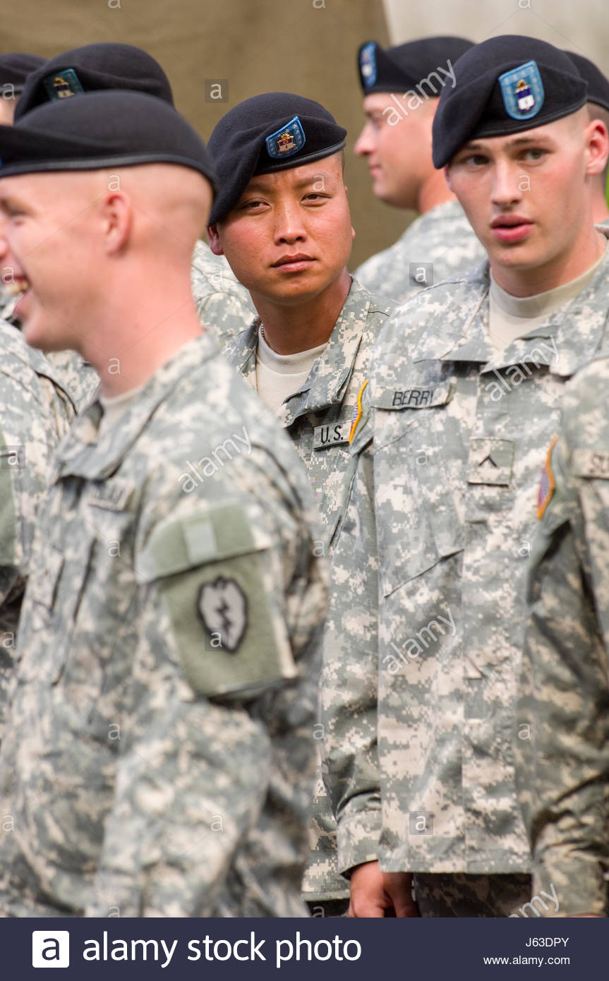 U.S. Army solders wearing the new Army Combat Uniform (ACU) waiting for the start of the salute to our troops parade, - Stock Image