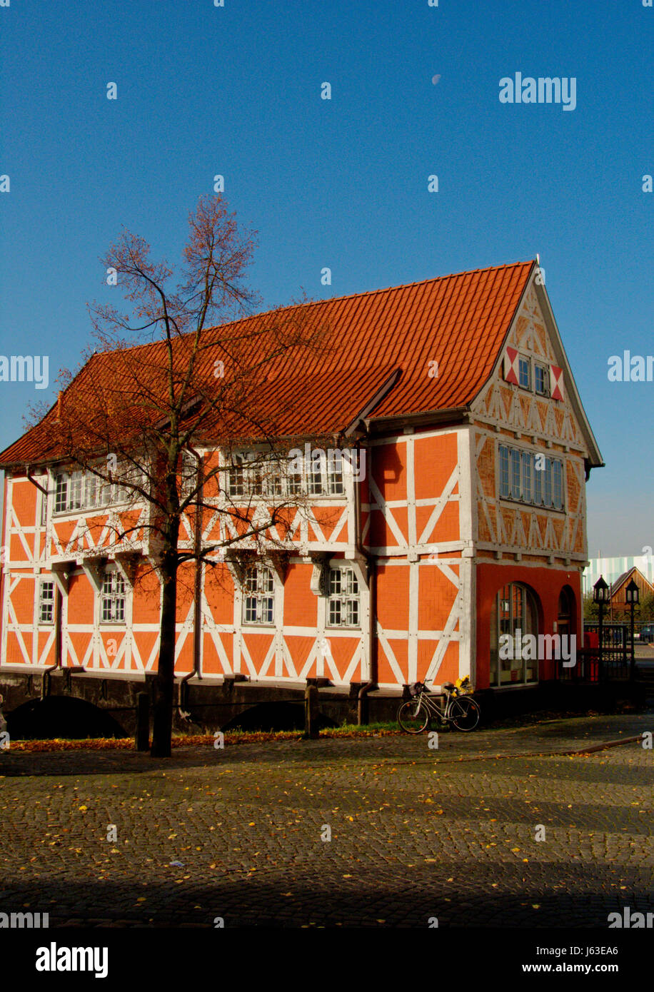 bridge Northern Germany gabled house bike bicycle cycle house building - Stock Image