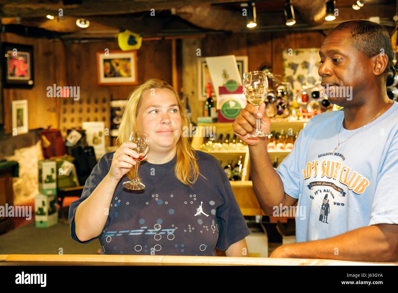 Michigan Grand Rapids Robinette Cellars wine tasting bar Black man woman couple wine sensory experience bouquet - Stock Image