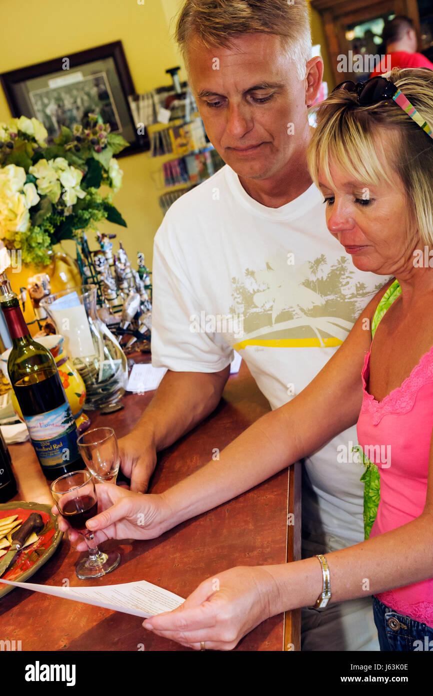 Michigan Traverse City Leelanau Peninsula Chateau Fontaine vineyard winery tasting room bar wine bottles menu sample Stock Photo