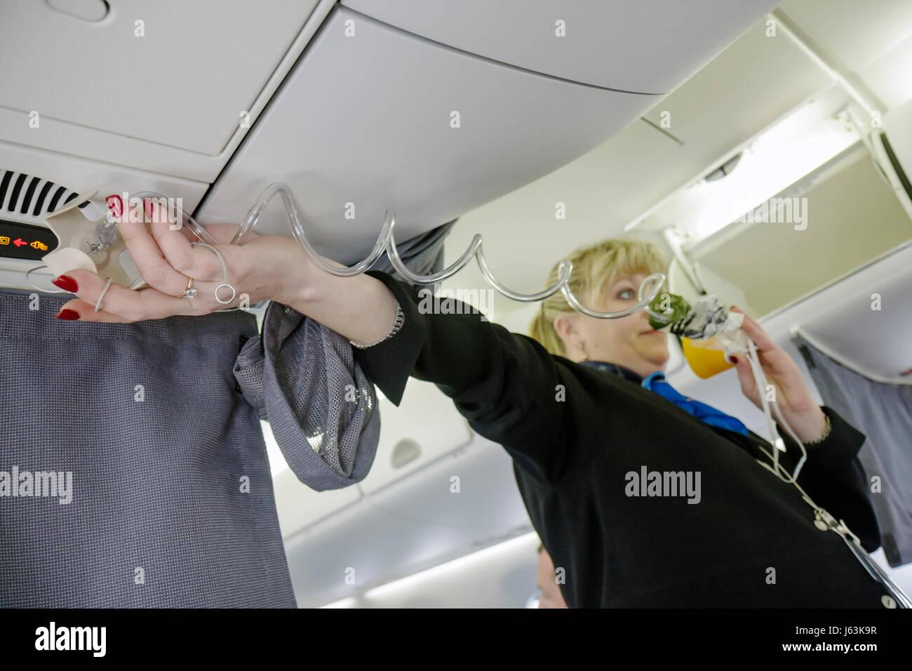 Michigan Detroit DTW Detroit Metropolitan Wayne County Airport Northwest Airlines safety instructions departure - Stock Image
