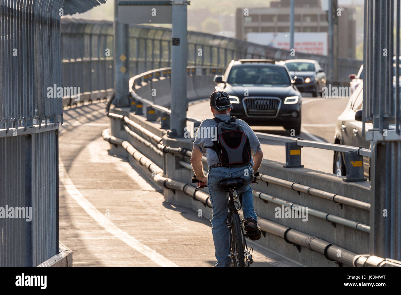 MONTREAL, CA - 18 May 2017: Cyclist on Jacques-Cartier Bridge's multipurpose path - Stock Image