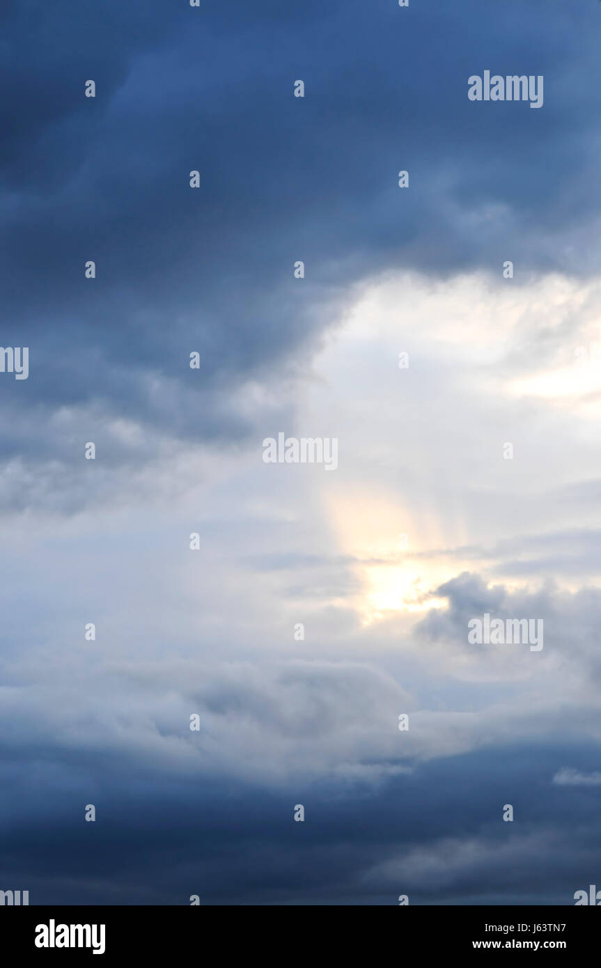 dramatic cloudy stormy clouds firmament sky blue cloud formation outdoor drama - Stock Image