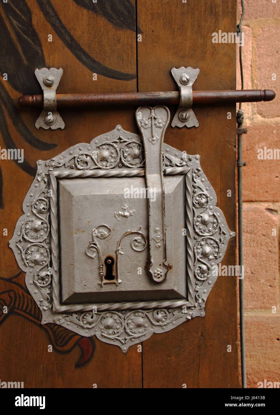A retro lock on a large wooden door - Stock Image