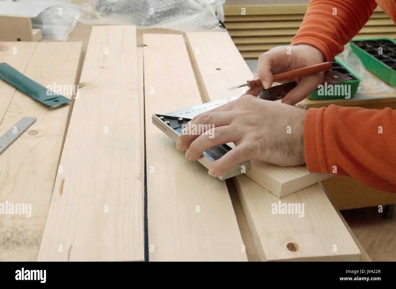 Woodworker making measurements Stock Photo