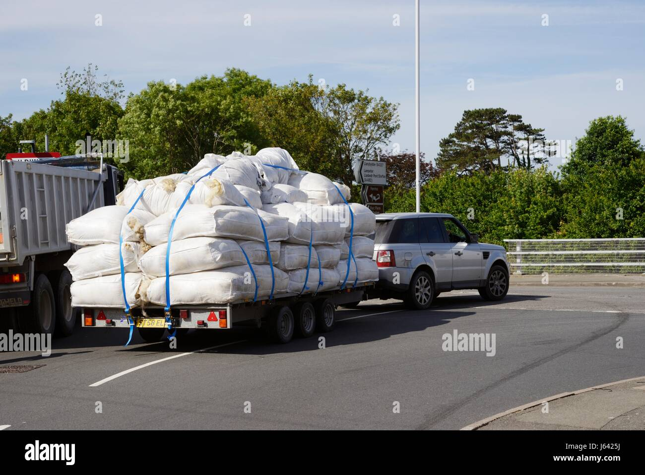 Sacks of sheep's wool, fleeces, being transported by road, Wales, UK - Stock Image
