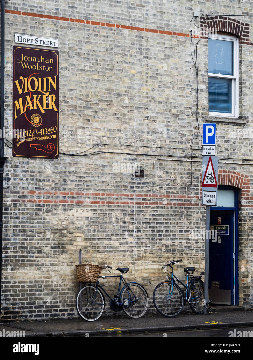 Signs outside the workshop of Jonathan Woolston, Violin