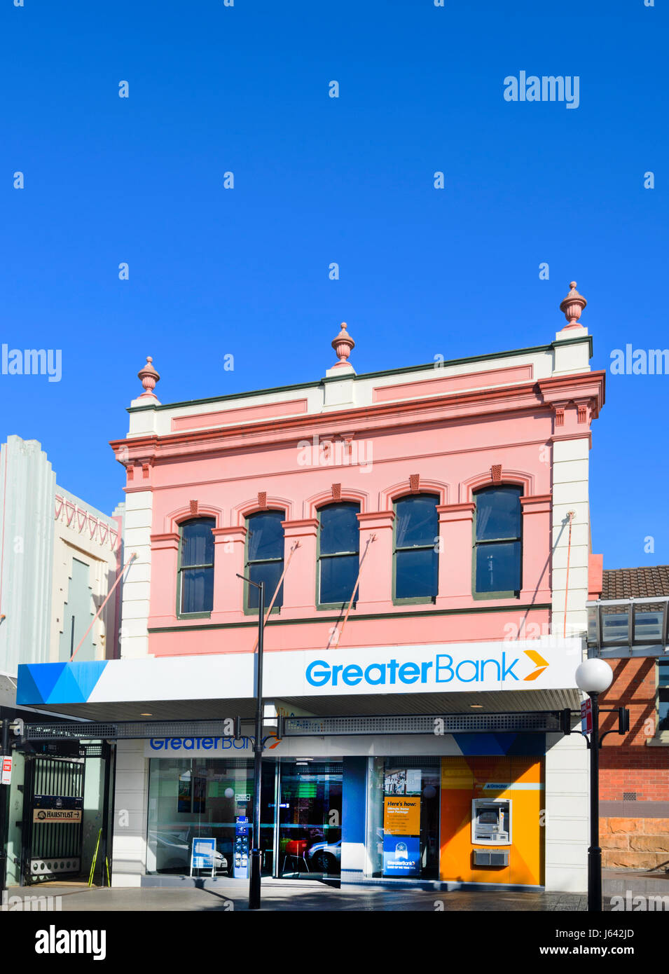 A Greater Bank branch in an old pink building, Junction Street, Nowra, New South Wales, NSW, Australia - Stock Image