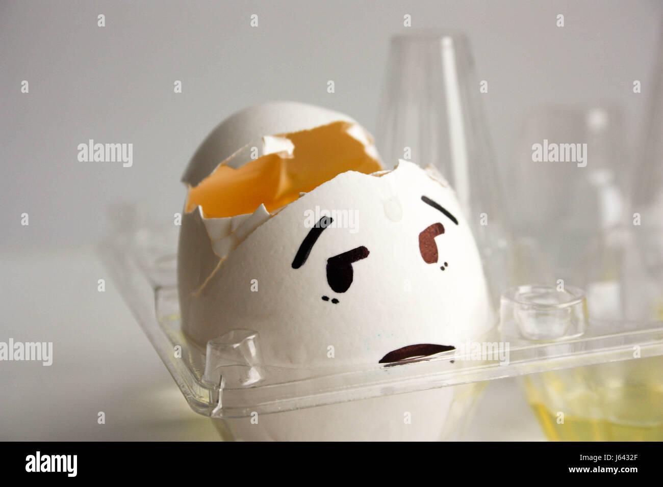 An egg with a face. Concept of headache. hangover. Photo for your design Stock Photo
