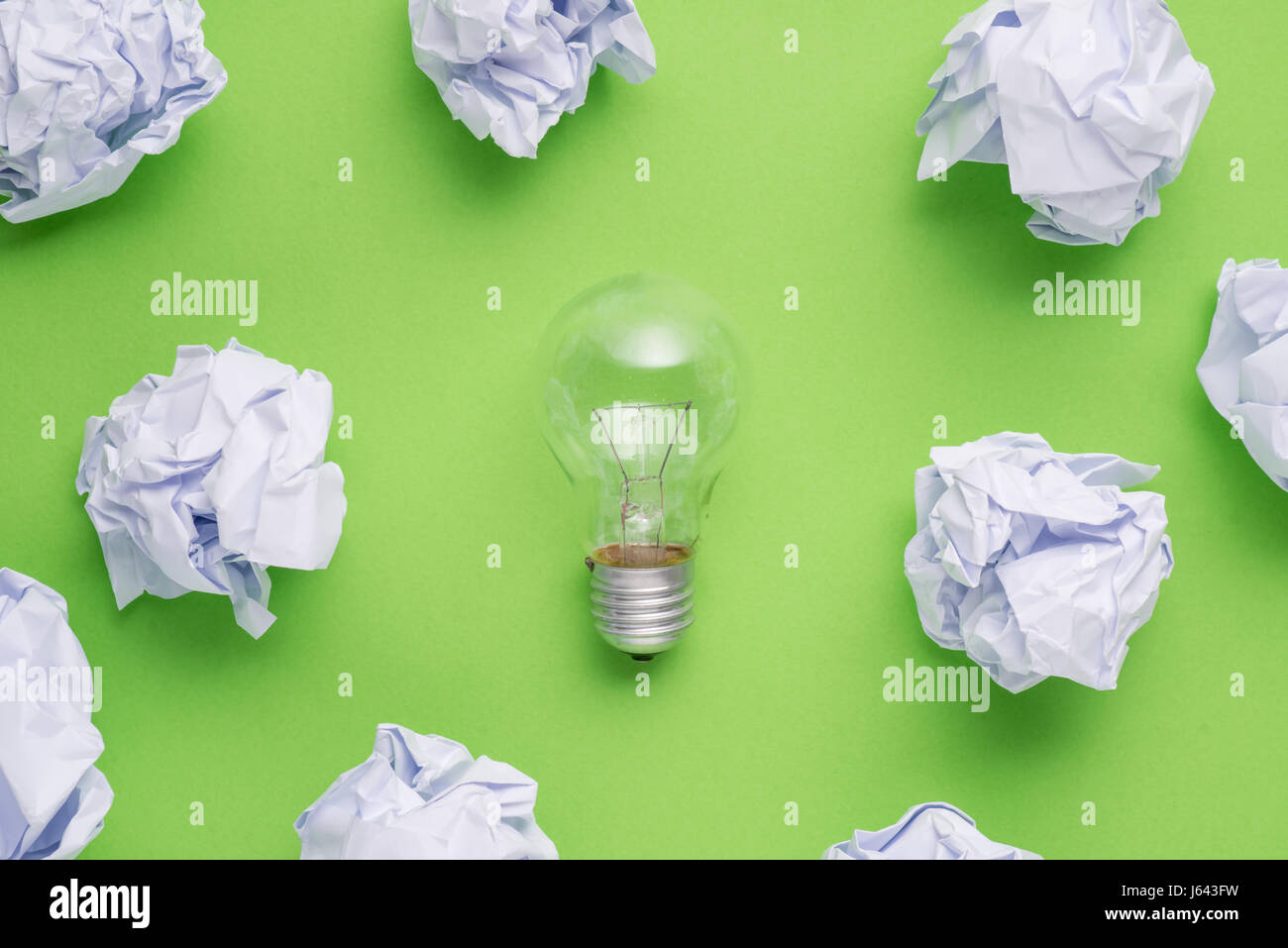 new idea concept with crumpled office paper and light bulb - Stock Image