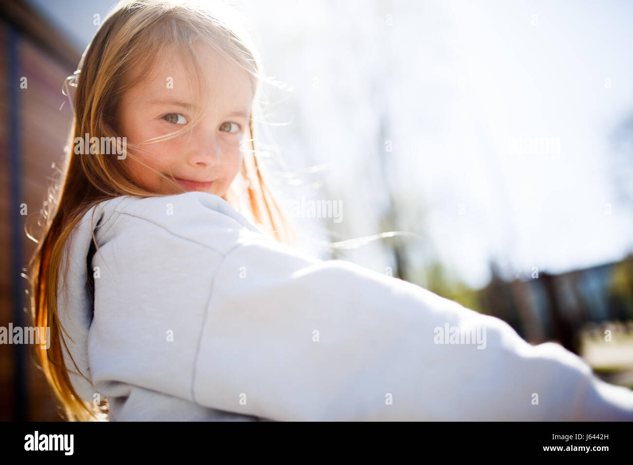 Portrait of girl at park - Stock Image