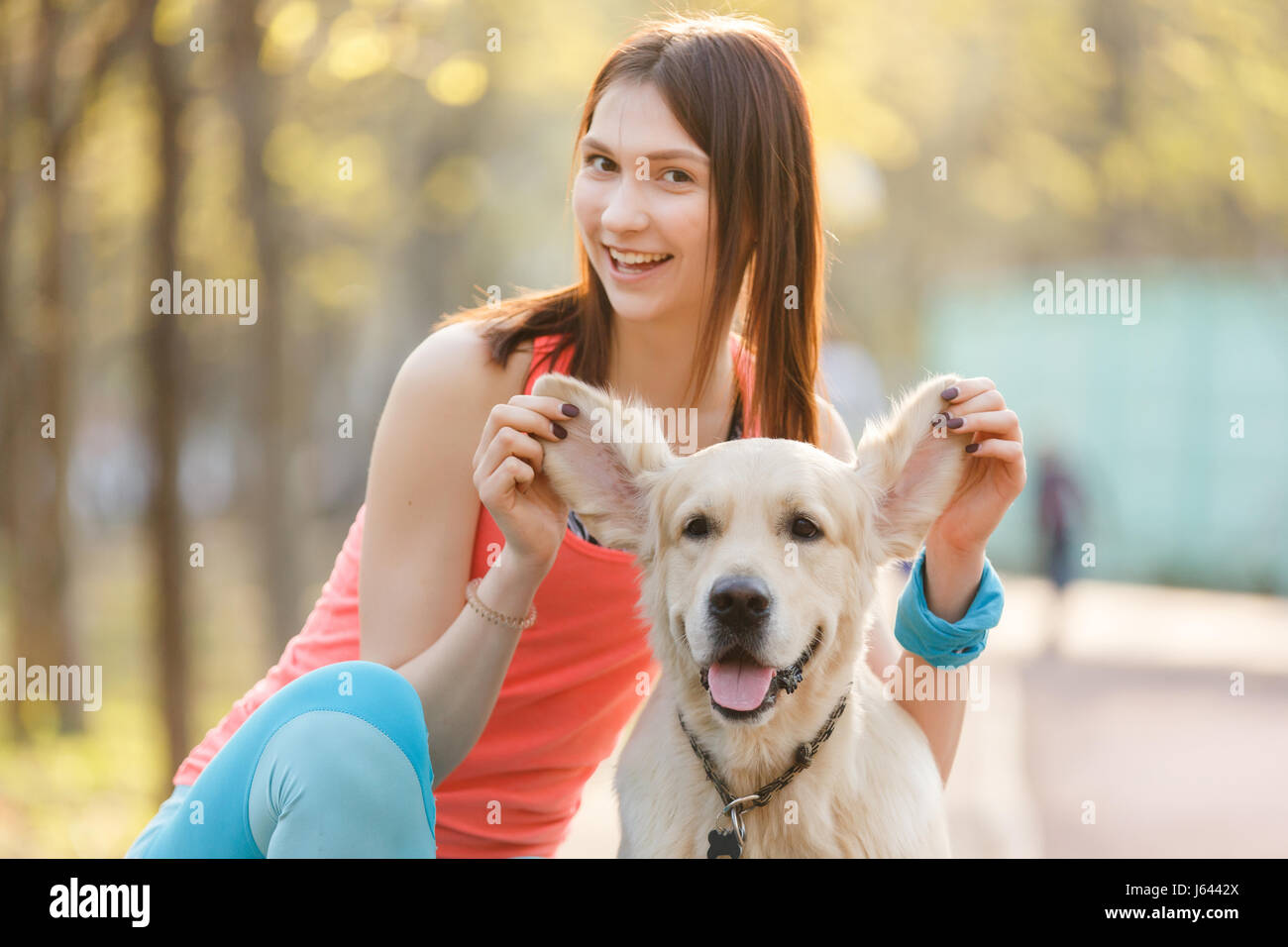Portrait of girl with labrador - Stock Image