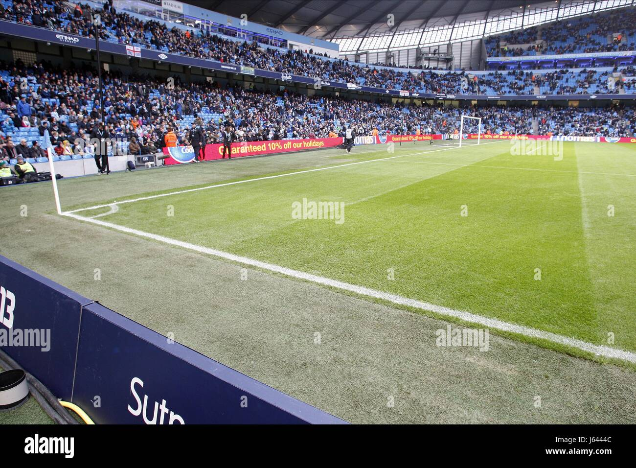 ADVERTISING BOARDS MOVED TO RE MANCHESTER CITY V STOKE CITY F ETIHAD STADIUM MANCHESTER ENGLAND 01 January 2013 - Stock Image
