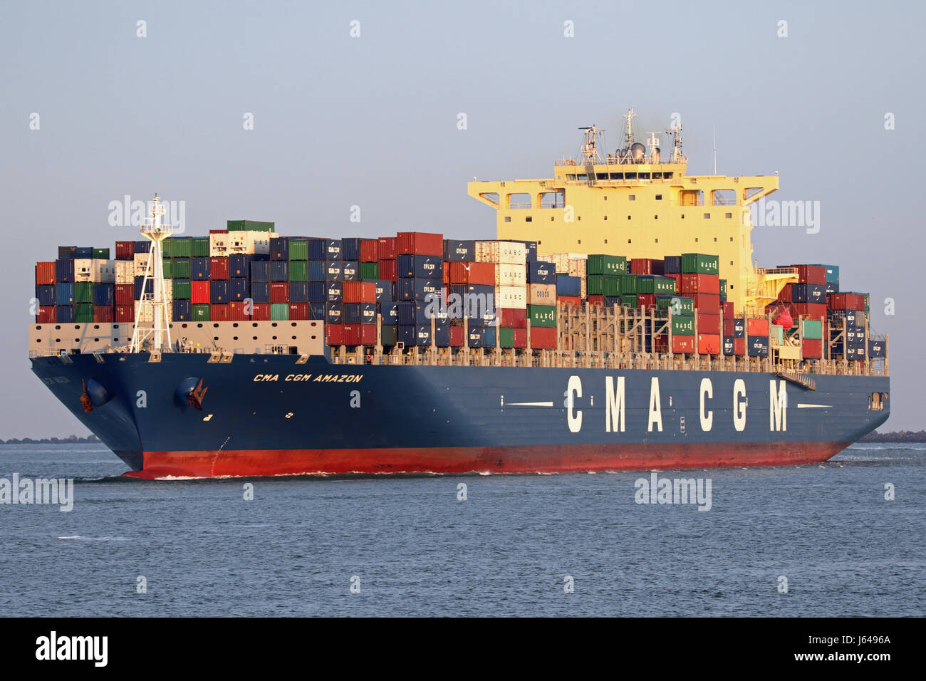 The container ship CMA CGM Amazon leaves the port of Rotterdam - Stock Image