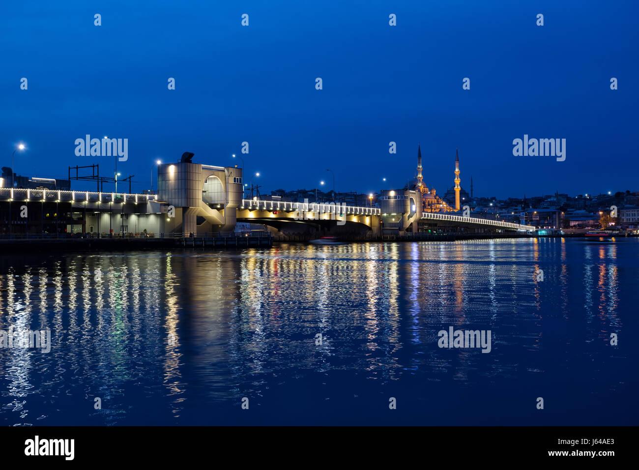 Galata bridge across the Bosphorus in the Istanbul at night. Istanbul, Turkey. - Stock Image