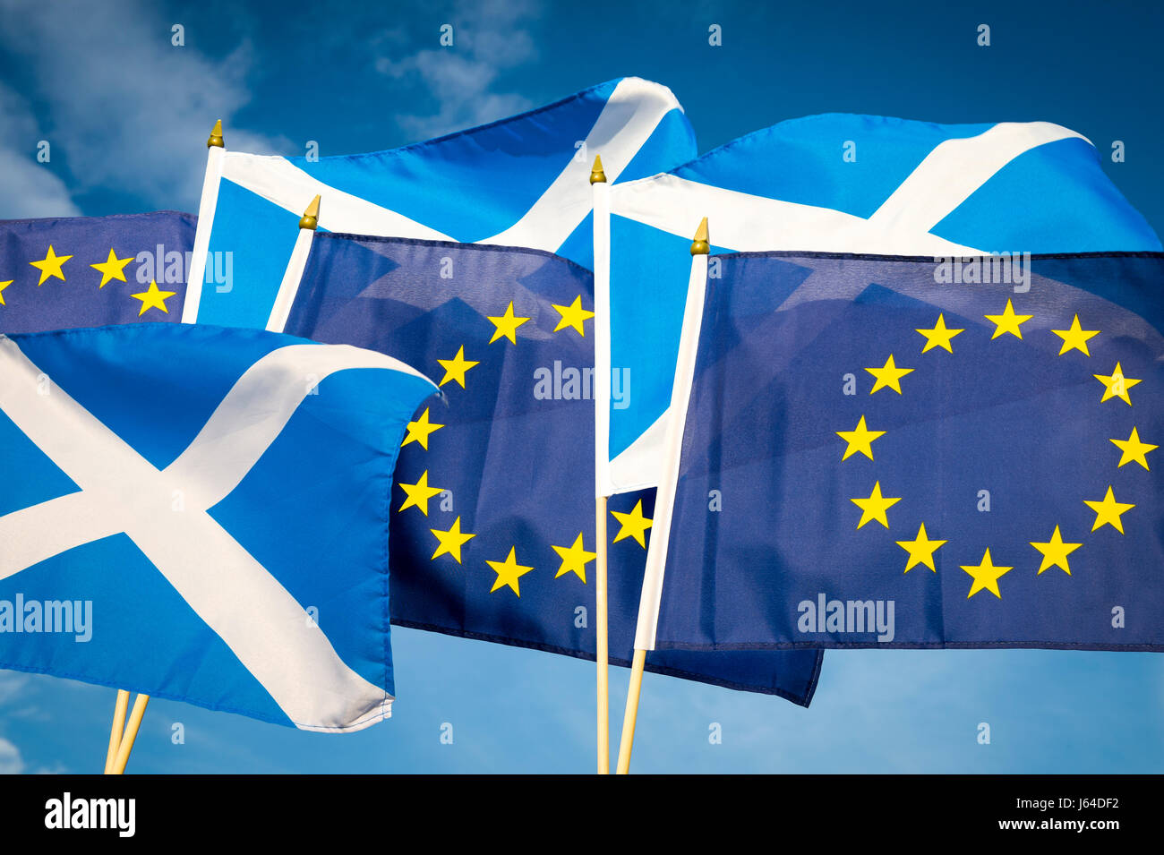 Flags of Scotland and the European Union flying together in the spirit of cooperation as Scotland considers its - Stock Image
