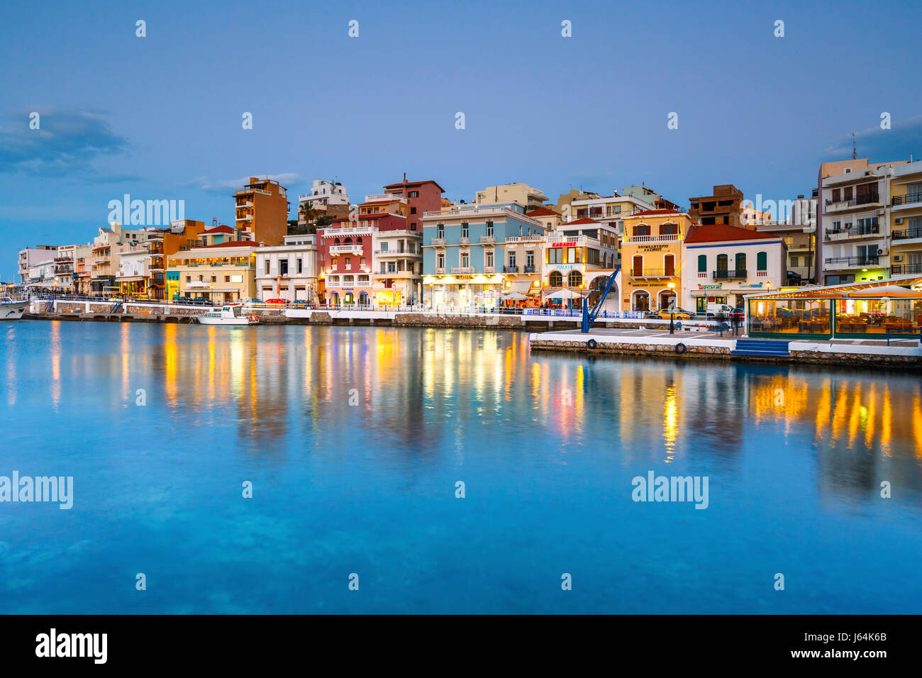Evening view of Agios Nikolaos and its harbor, Crete, Greece. - Stock Image