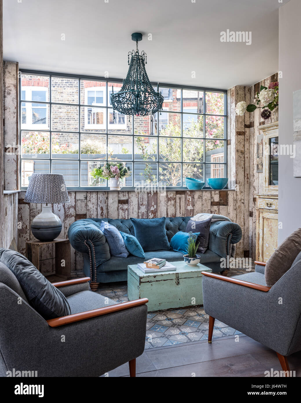 Mid Century Armchairs And Velvet Chesterfield Sofa In Sitting Room