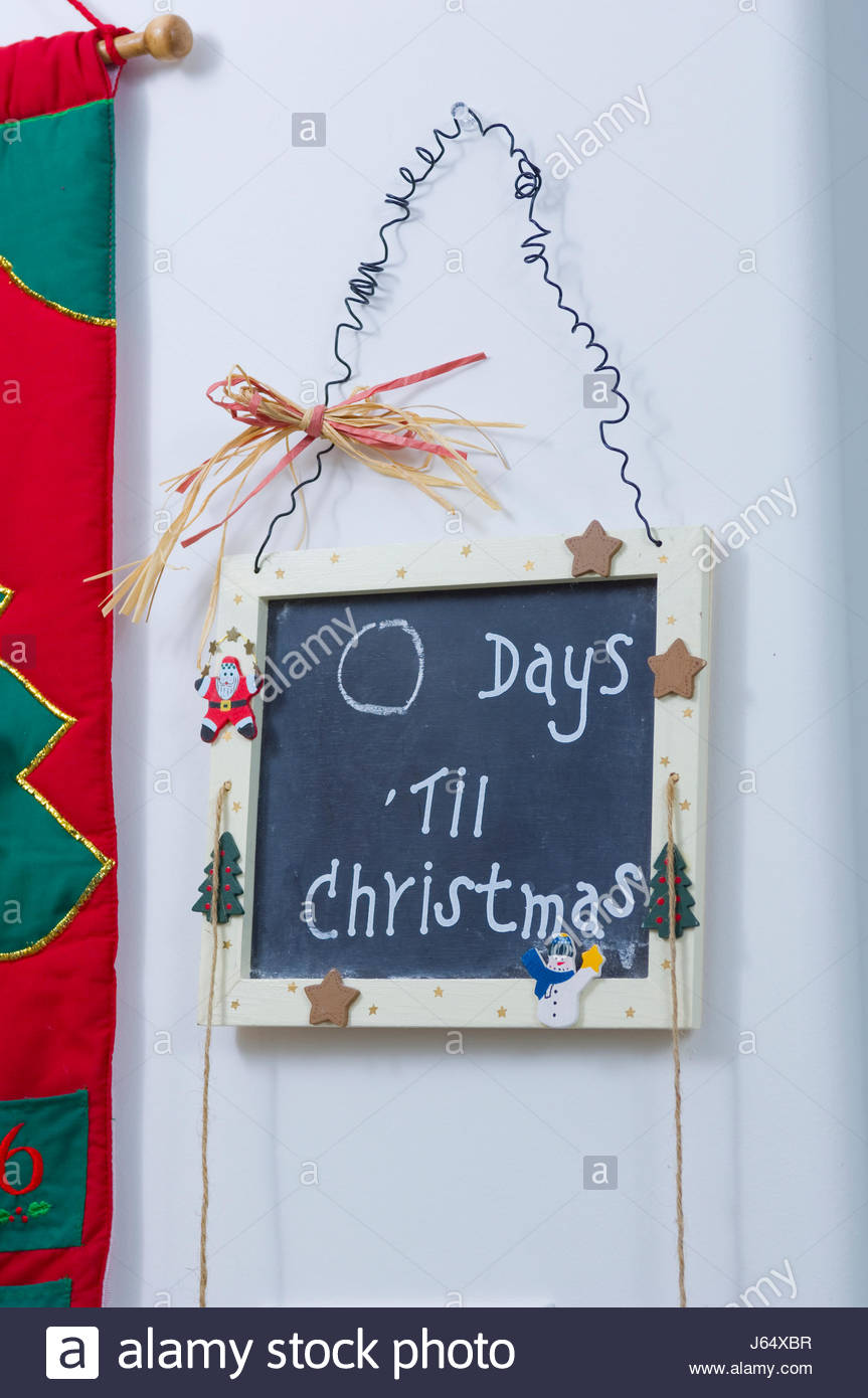 Days Till Christmas Chalkboard.A Chalkboard Decorated With A Christmas Theme With 0 Days