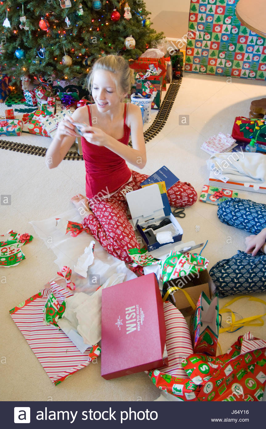 Teenager Gifts For Christmas.Teenage Girl With Blonde Hair Opening Gifts On Christmas