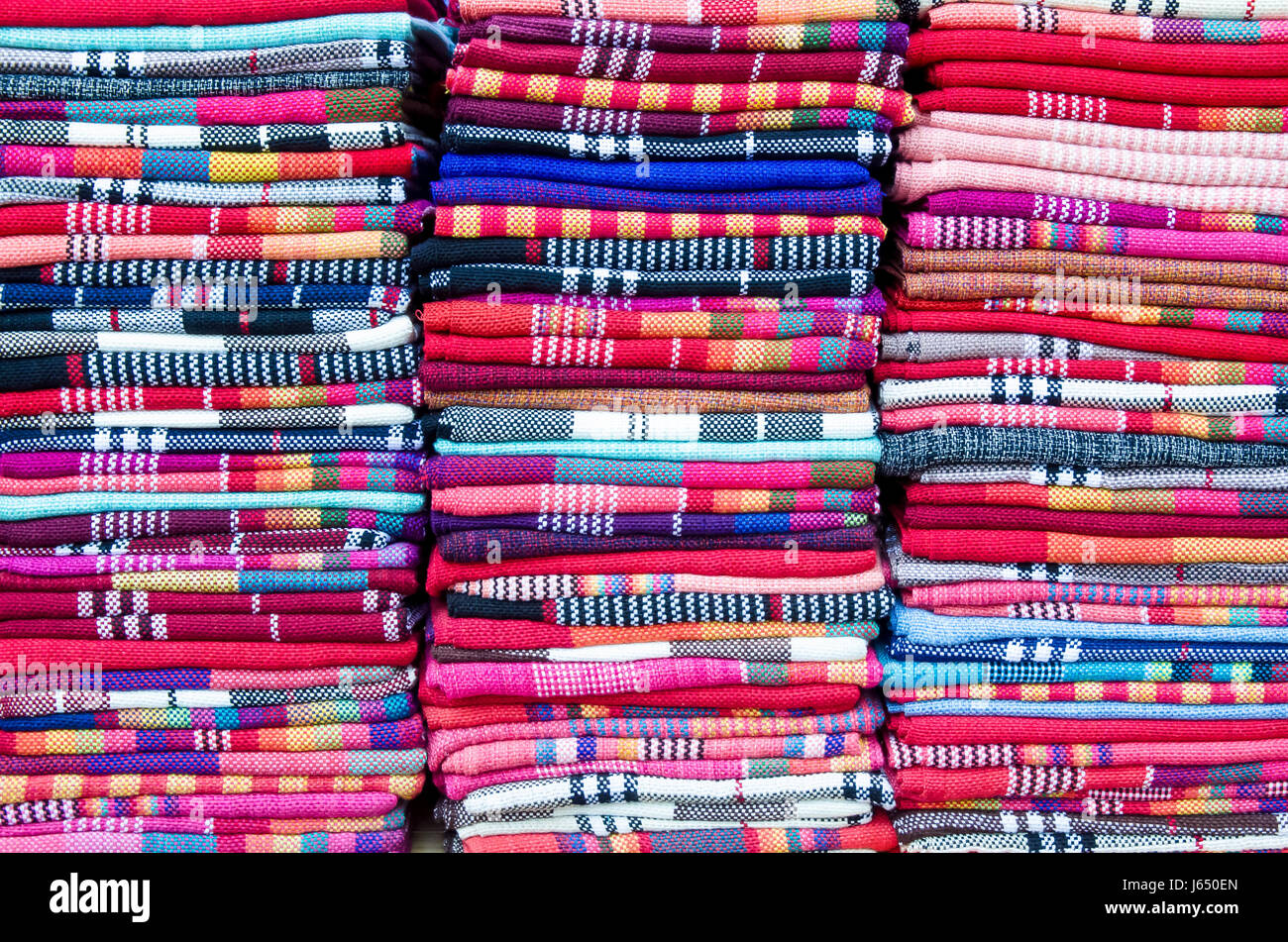 Colorful scarves selling in the store of Old Town of Lijiang.Yunnan - Stock Image