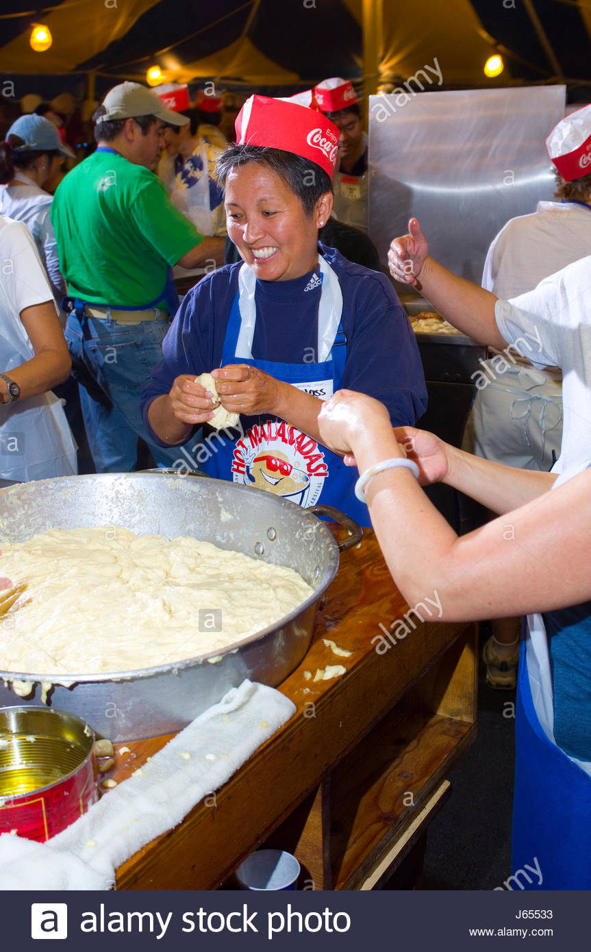 Class of 1977 alumni making malasadas that will be sold at the 2007 Punahou Carnival, Honolulu Oahu Hawaii USA 2007 - Stock Image
