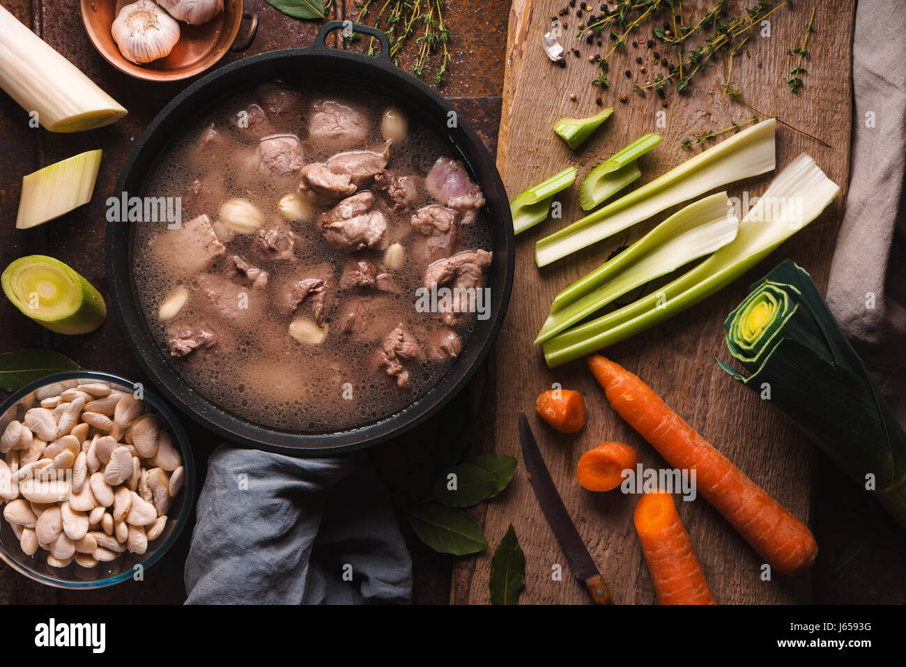 Preparation of cassoulet with pork and lamb and vegetables top view - Stock Image