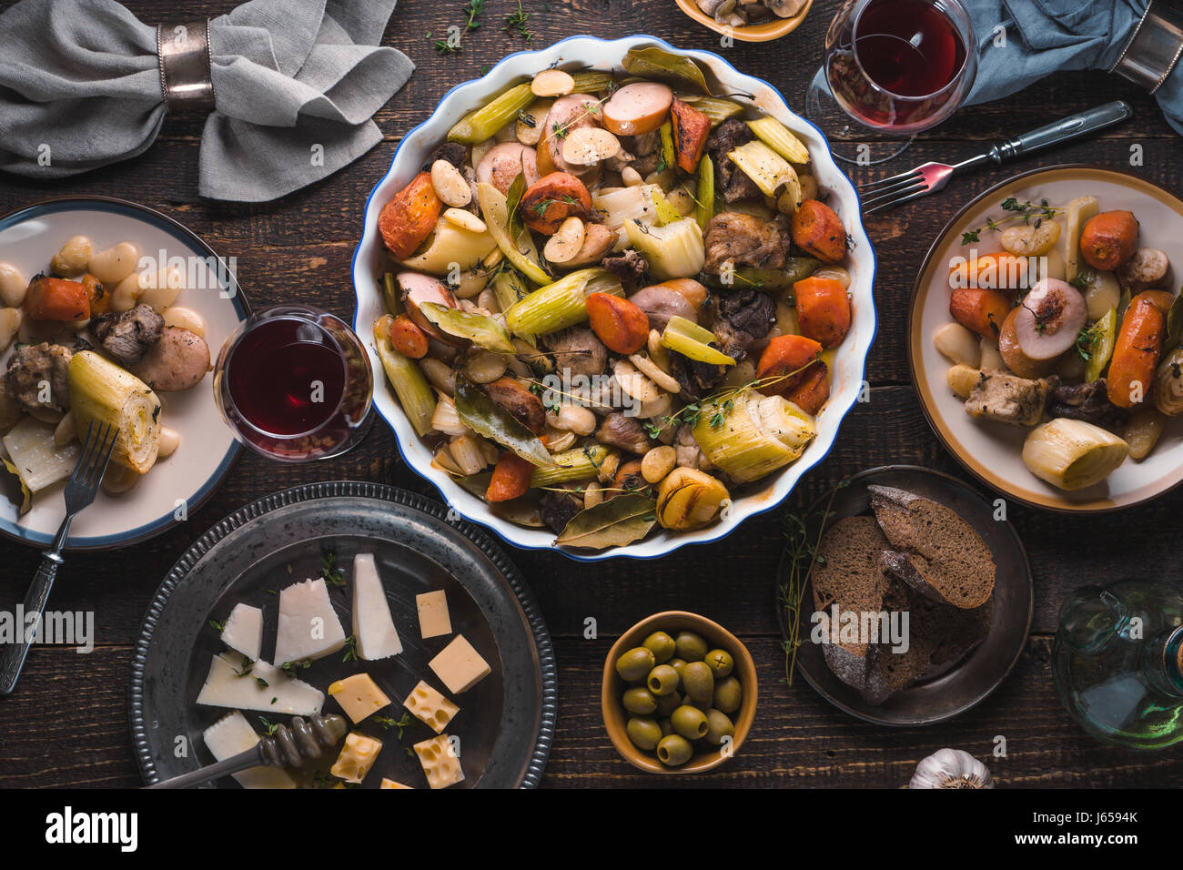 Kasul, cheese, wine, vegetables on the table closeup Stock Photo