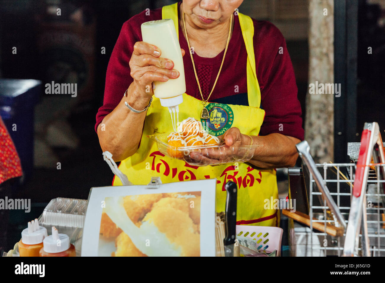CHIANG MAI, THAILAND - AUGUST 21: Woman prepare food for sale at the Sunday Market (Walking Street) on August 21, - Stock Image
