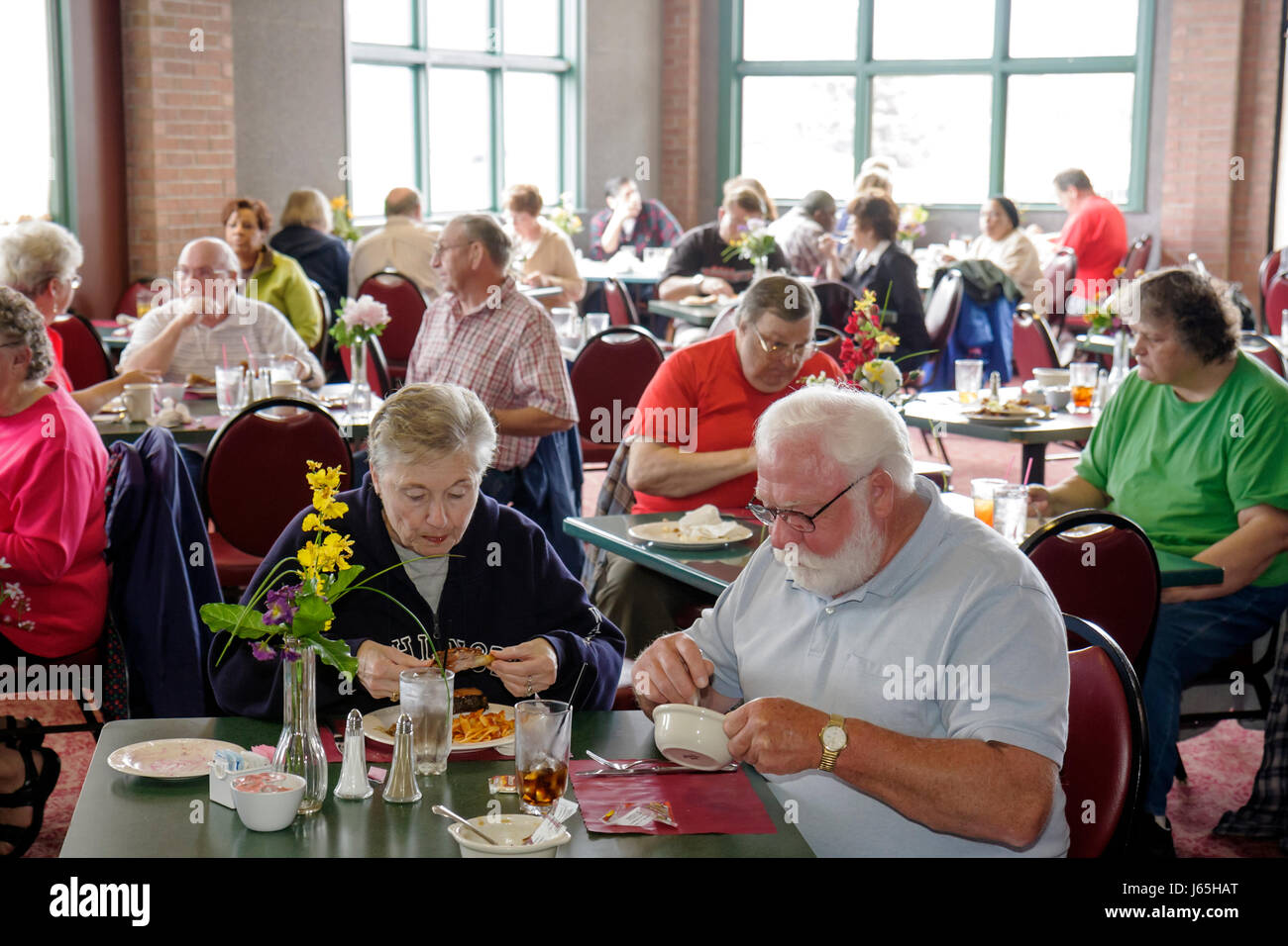 Saginaw Michigan Township Horizon's Conference Center buffet restaurant food dining man woman couple senior - Stock Image