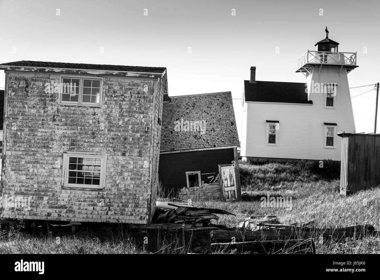 Lighthouse and sheds at harbor, North Rustico, Prince Edward Island, Canada - Stock Image