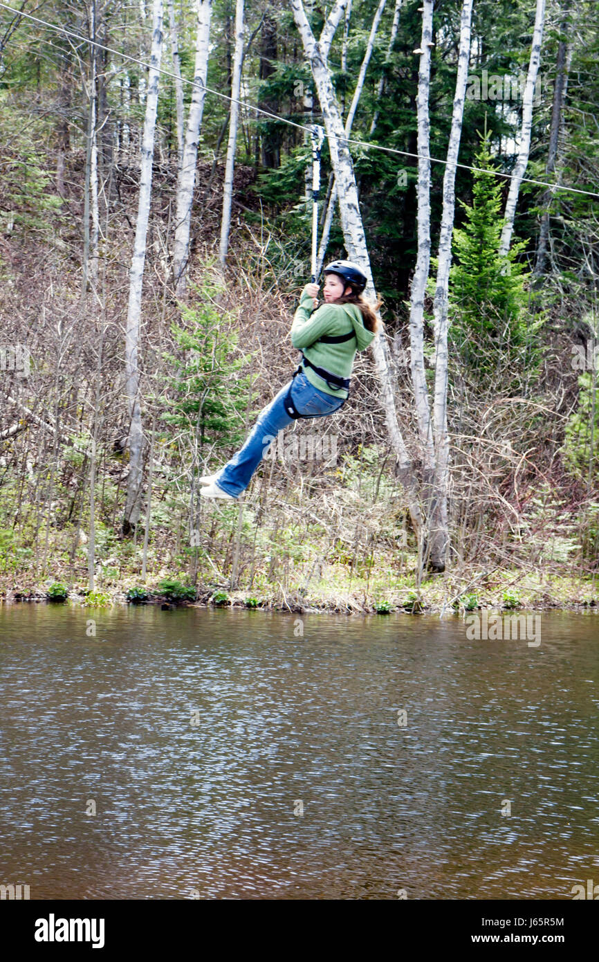 Mackinaw City Michigan Mackinac State Historic Parks Park Historic Mill Creek Discovery Park teen girl zip line - Stock Image