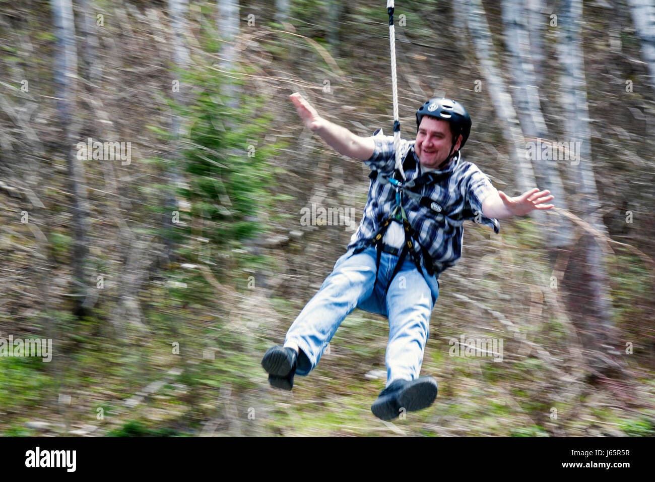 Mackinaw City Michigan Mackinac State Historic Parks Park Historic Mill Creek Discovery Park man zip line sliding - Stock Image