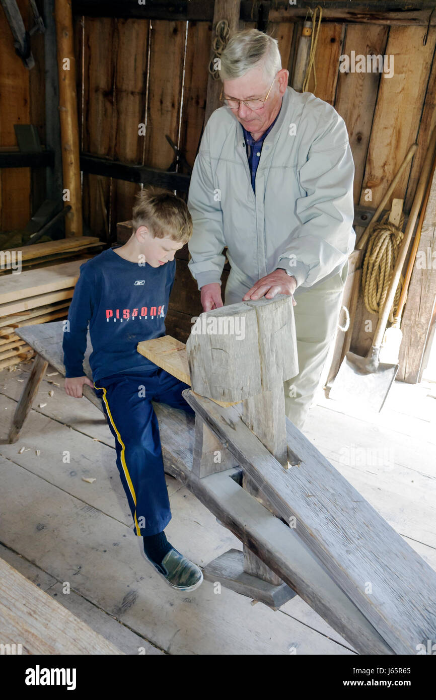 Mackinaw City Michigan Mackinac State Historic Parks Park Historic Mill Creek Discovery Park British Workshop man - Stock Image